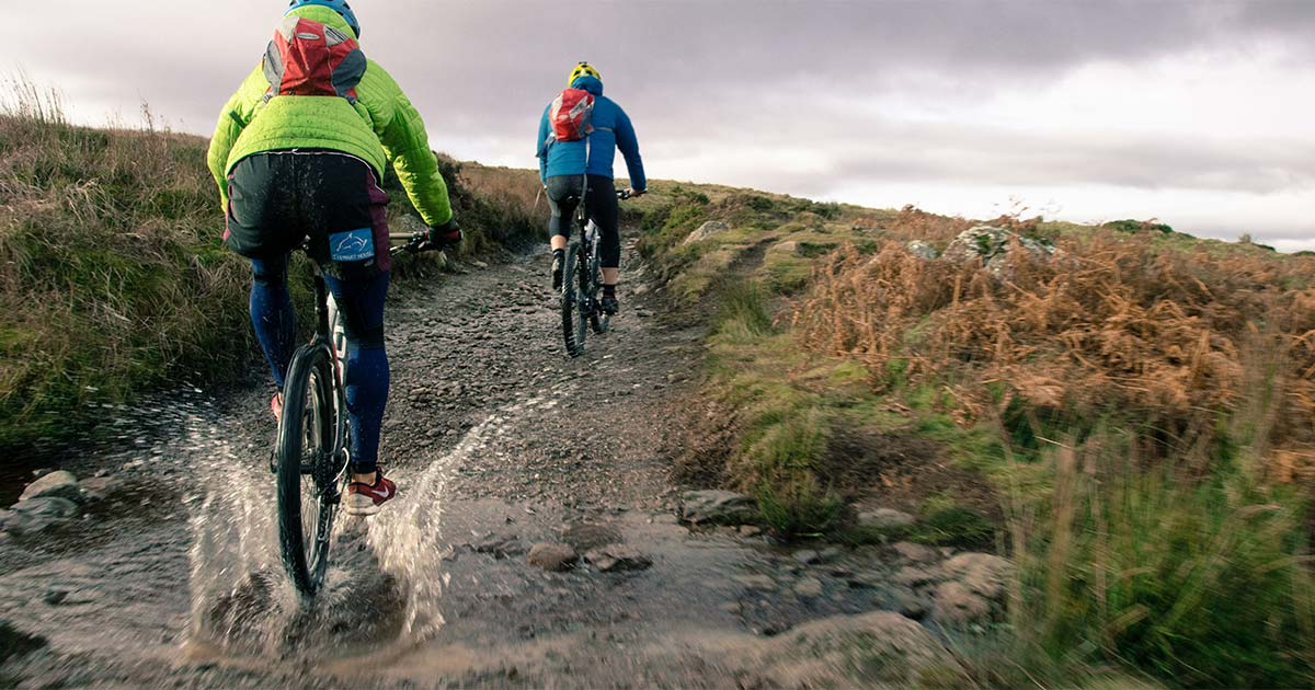 2 people mountain biking on the fells