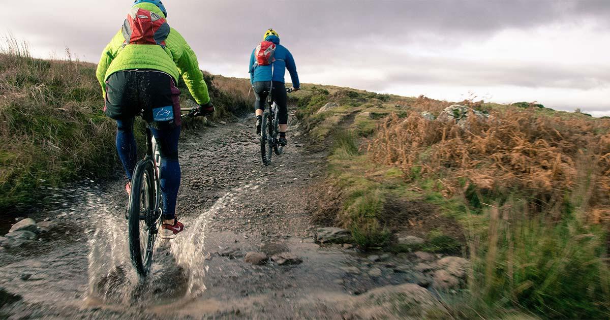 2 people mountain biking on the fells