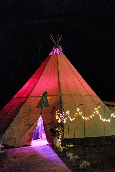 Tipi lit up at night for a wedding reception at Another Place, The Lake - a new hotel in the Lake District