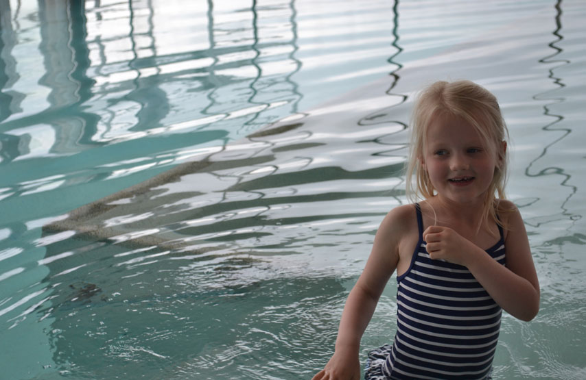 Young girl in the swimming pool at Another Place, The Lake - a new hotel in the Lake District