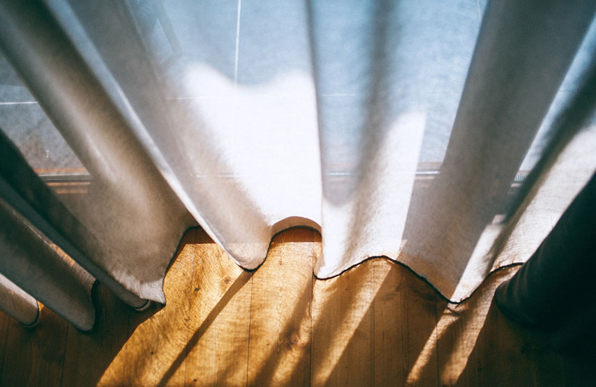Light leaking through the curtains in a bedroom at Another Place, The Lake - a new hotel beside Ullswater
