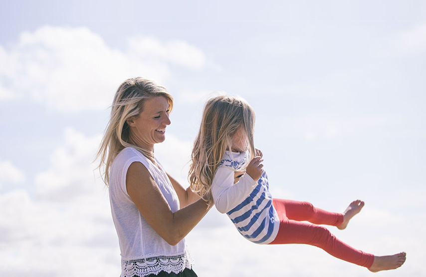 Mother and daughter playing in the sunshine during their family holiday in the Lake District
