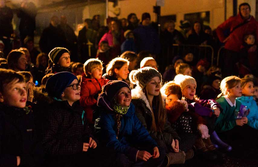 Kids watching the outdoor films at Kendal Mountain Festival