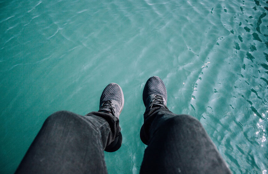 Feet dangling over the lake