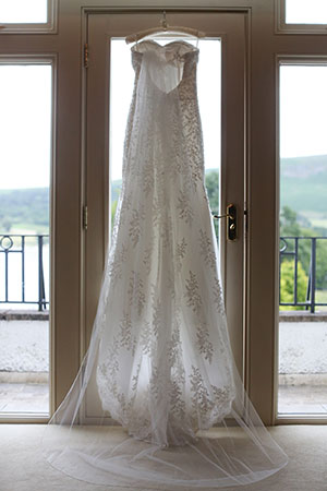 Wedding dress hanging in a bedroom at Another Place, The Lake in Ullswater