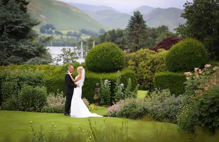 Bride and groom on their wedding day with Ullswater in the background