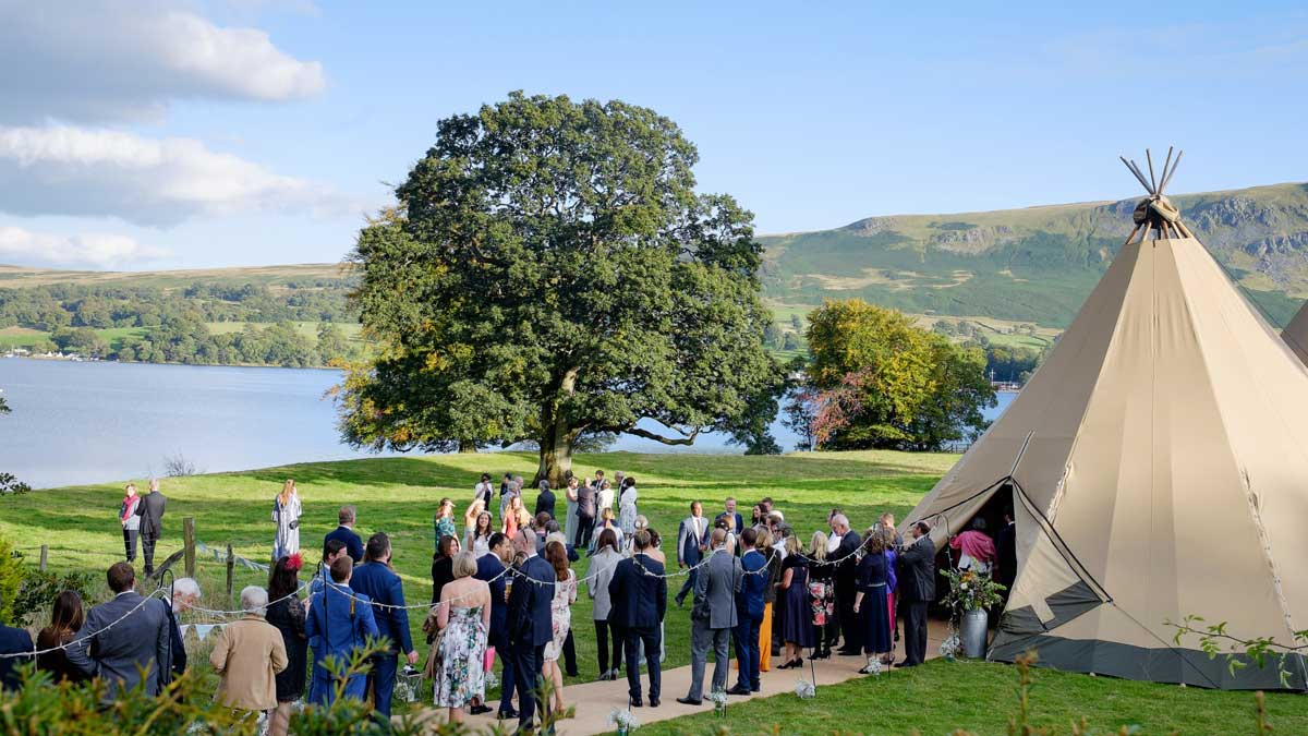Gathering outside a tipi before the wedding reception at Another Place, a new hotel overlooking Ullswater