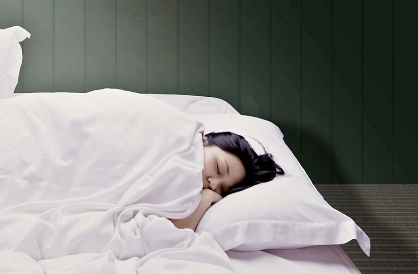 Girl sleeping in a bedroom at Another Place - a new hotel in the Lake District