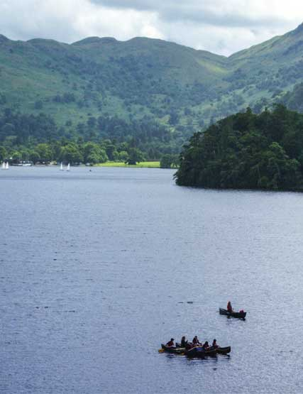 A group kayaking on Ullswater