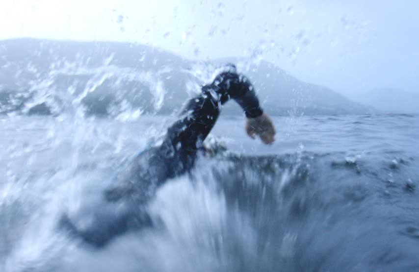 Close-up shot of man swimming in Ullswater during a Swim Clinic at Another Place, The Lake