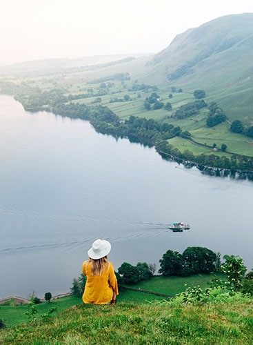 Hayley Anderson sitting overlooking Ullswater