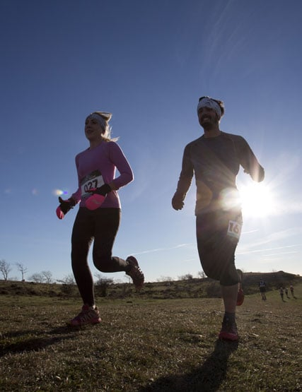 Couple taking part in a running event at Kendal Mountain Festival