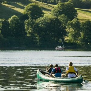 Family canoeing on Ullswater. Photo: Crag Hoppers shoot | Cumbria Tourism Library