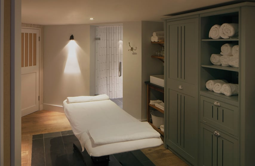 A bed in a treatment room in Swim Club at Another Place, The Lake - Ullswater's new hotel