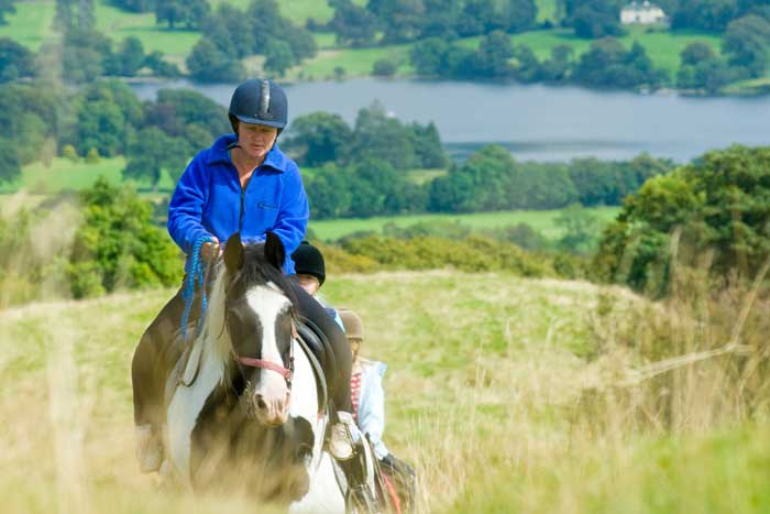 Woman horse riding around the lake. Photo: Cumbria Tourism Library