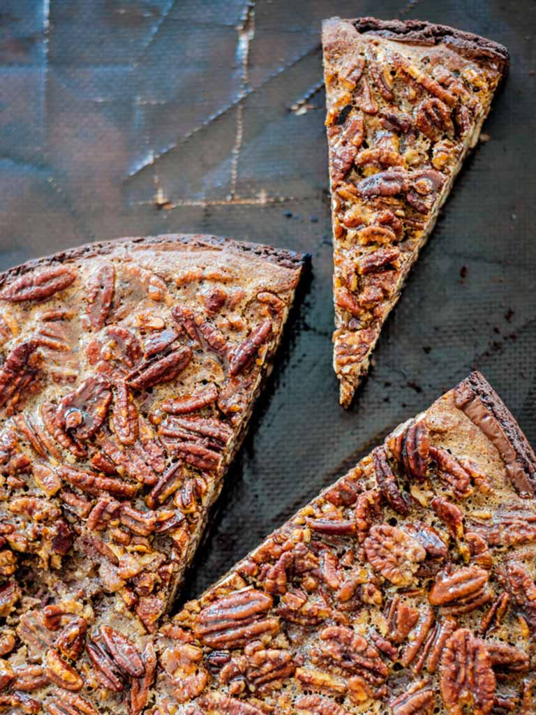 A slice of chocolate and pecan pie on a baking tray in the kitchen at Another Place