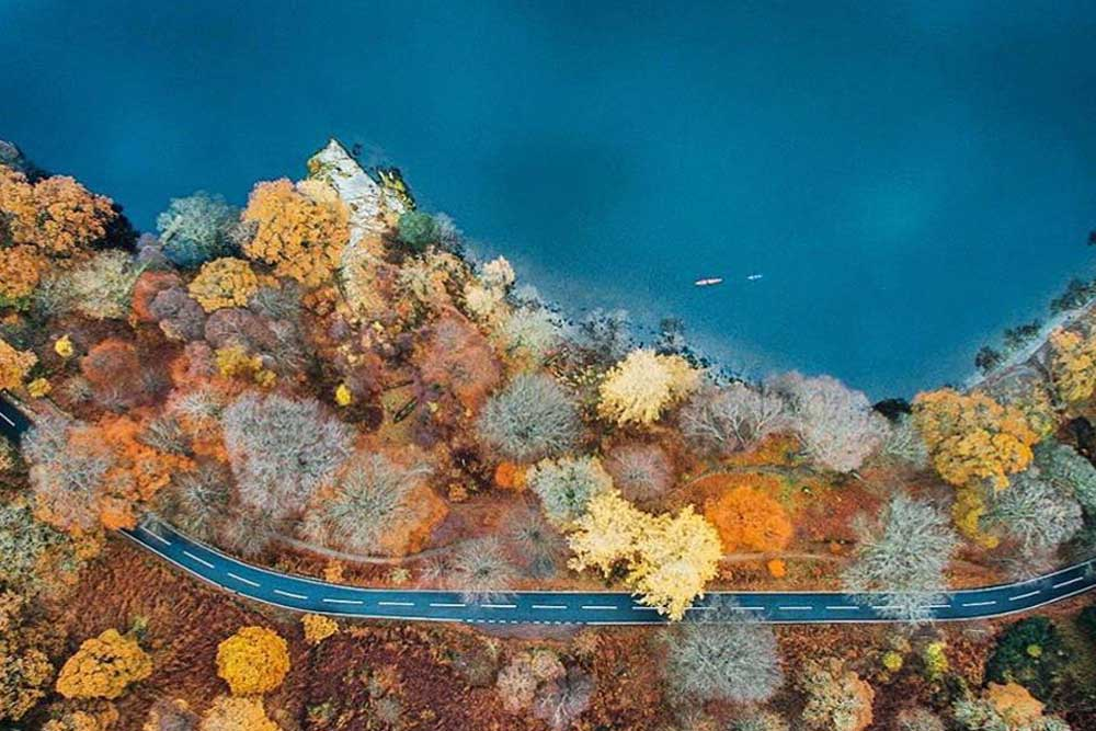 Ullswater bursting with autumn colour shot from above with a drone. Photo: Jack Boothby