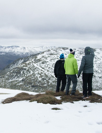 Friends exploring the snow-covered fells in the Lake District