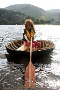 Kevin Rushby's daughter tests out a coracle on Ullswater in the Lake District