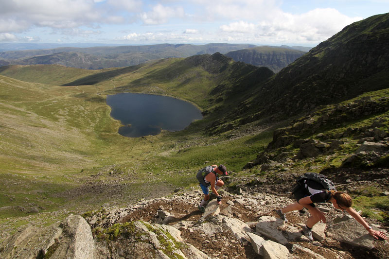 Triathlon competitors above Red Tarn in the Lake District