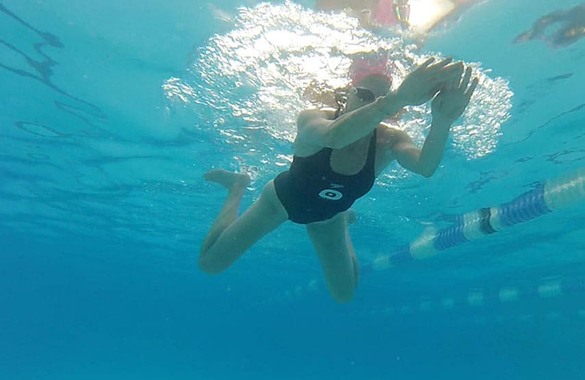 A woman swimming breaststroke at Swim Clinic