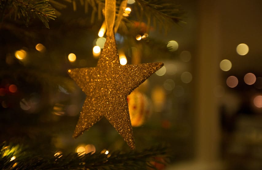 Star decoration hanging from the Christmas tree at Another Place, The Lake