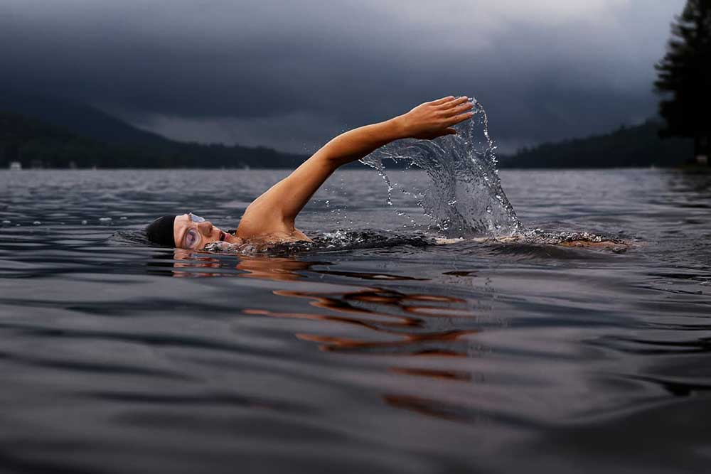 Woman wild swimming in a lake