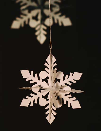 A snowflake decoration hanging from the Christmas tree at Another Place, The Lake in the Lake District
