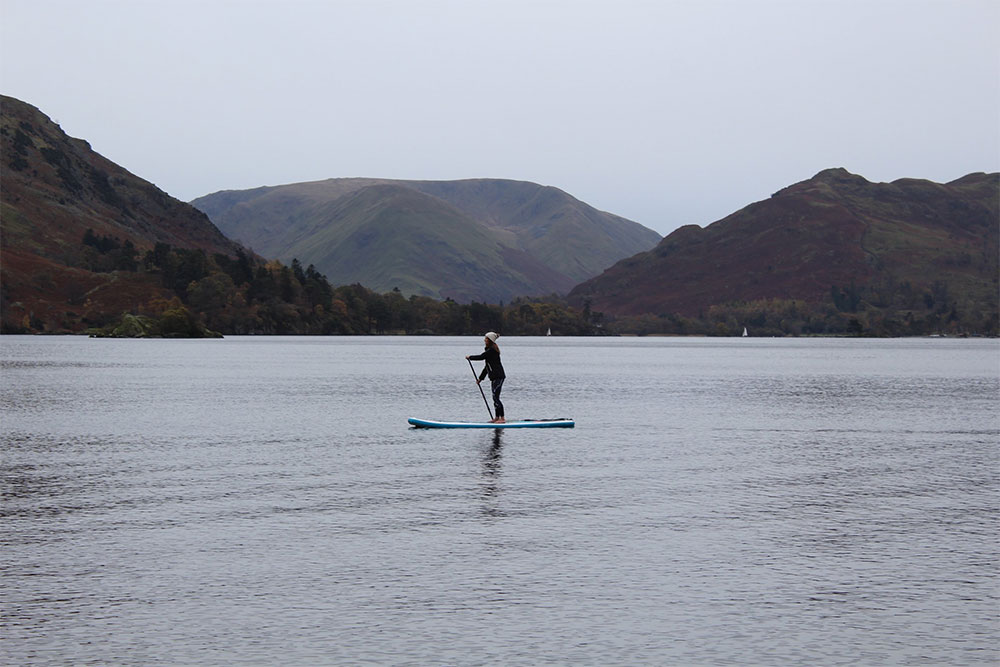 Woman stand up paddleboarding on the lake