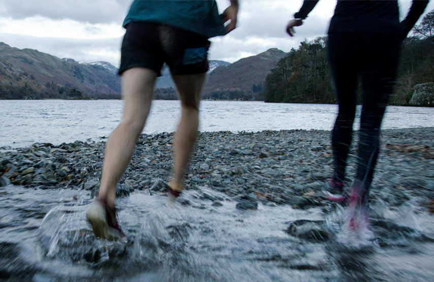 Runners on the hsore of Ullswater