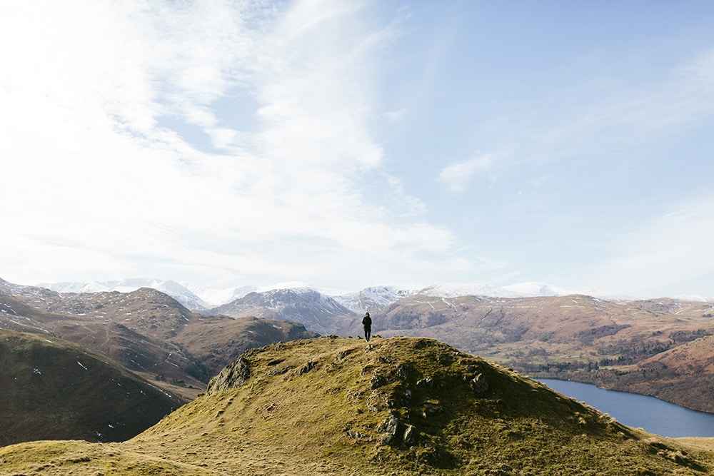Woman standing on top of the fells