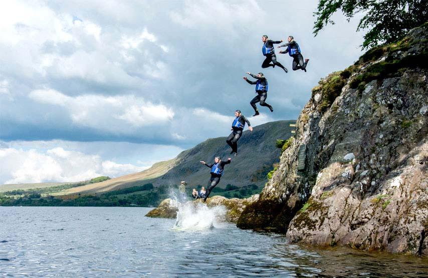 Man jumping into Ullswater off Kailpot Crag