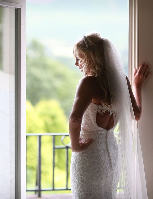Bride on her wedding day looking out over the fells