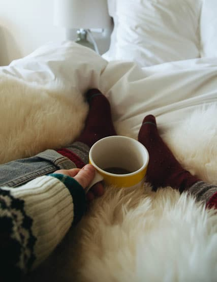Relaxing with a coffee in bed