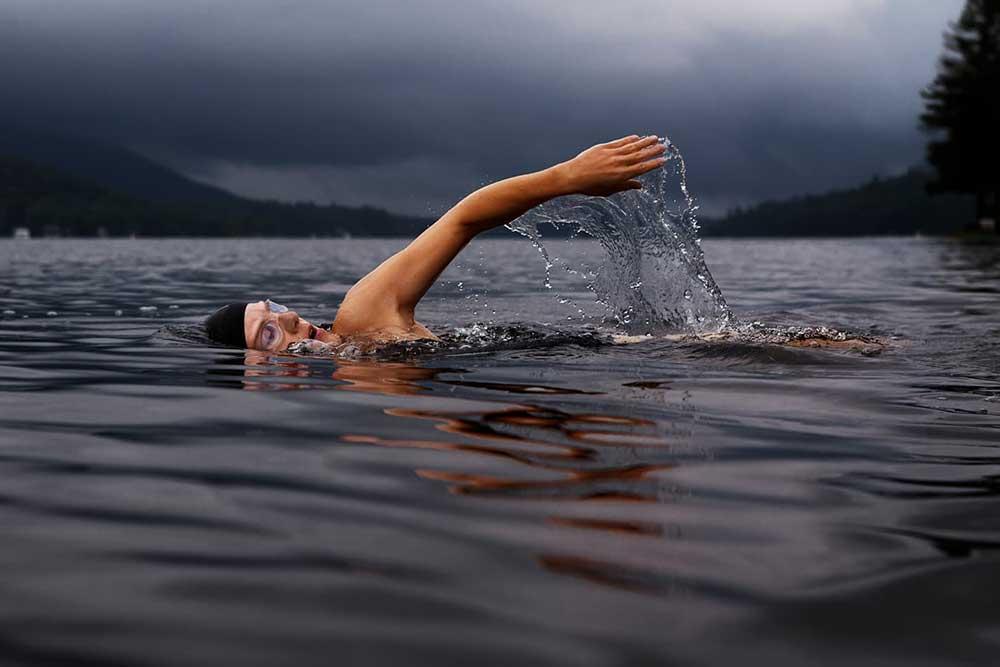 Woman wild swimming in a lake