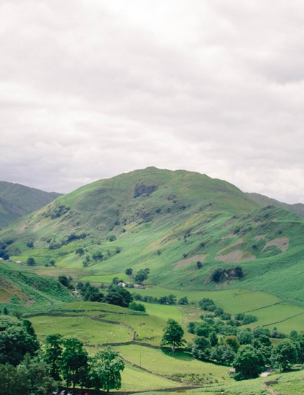 The fells and scenery surrounding the lake