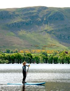Stand up paddleboarding on Ullswater lake