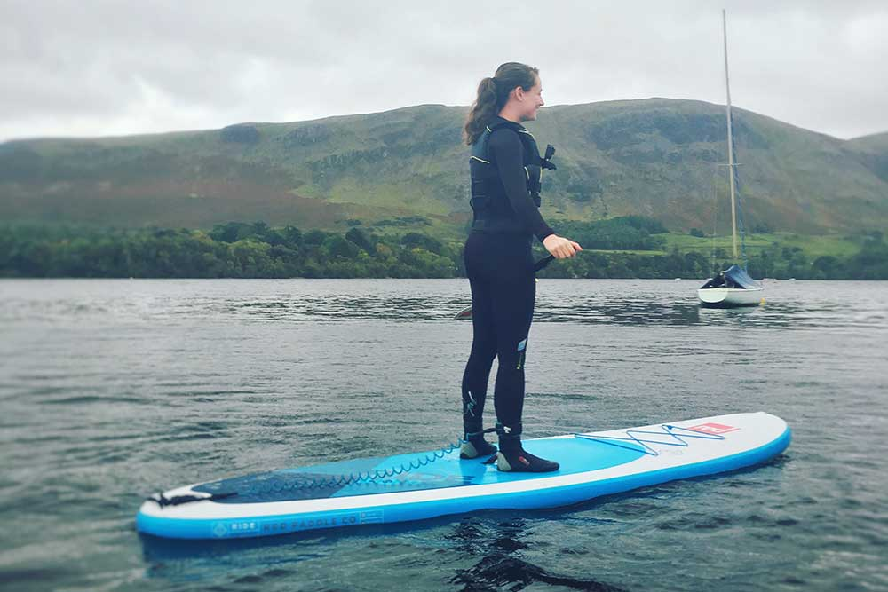 Fiona stand-up paddleboarding on Ullswater