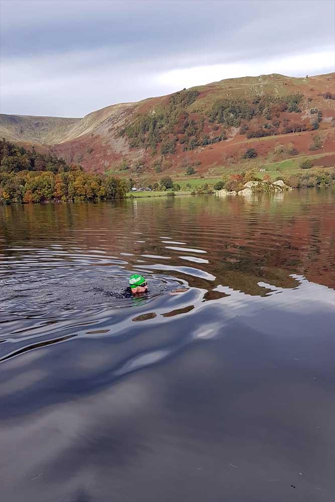 Wild swimming across Ullswater