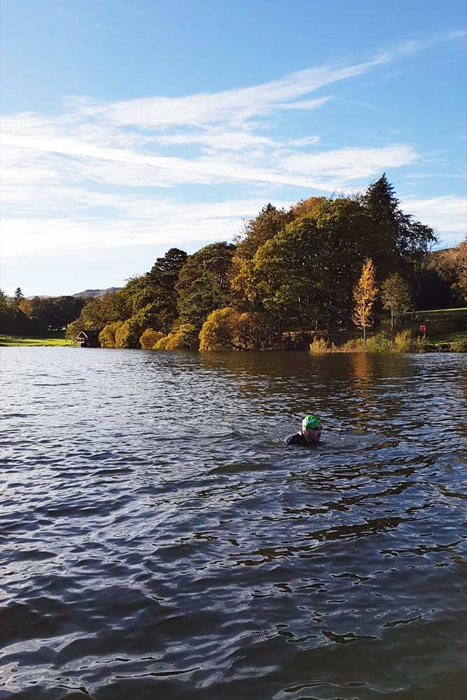 Alex Lester swims along the shores of Ullswater