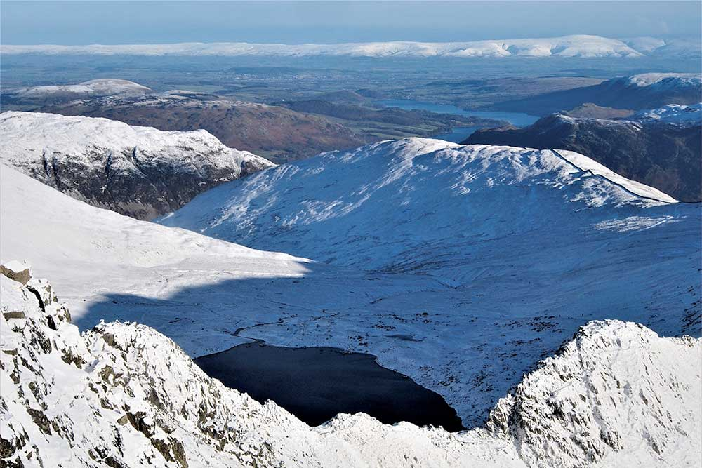 View across the fells from Helvellyn in the snow