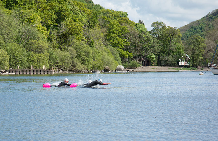 Group of open water swimmers in Ullswater