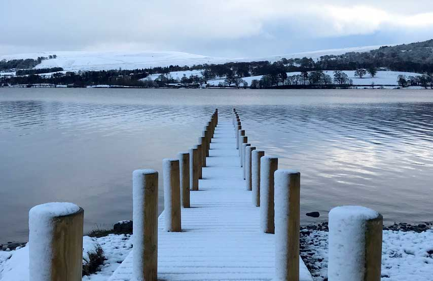 The hotel jetty covered in snow at Christmas