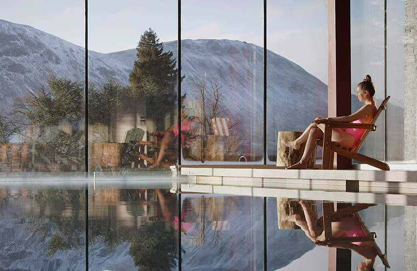 Relaxing by the hotel swimming pool with snow outside