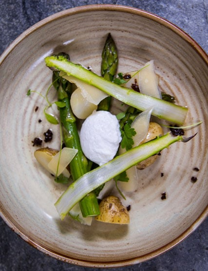 English asparagus and Jersey Royals, slow-cooked pheasant egg, parmesan and truffle