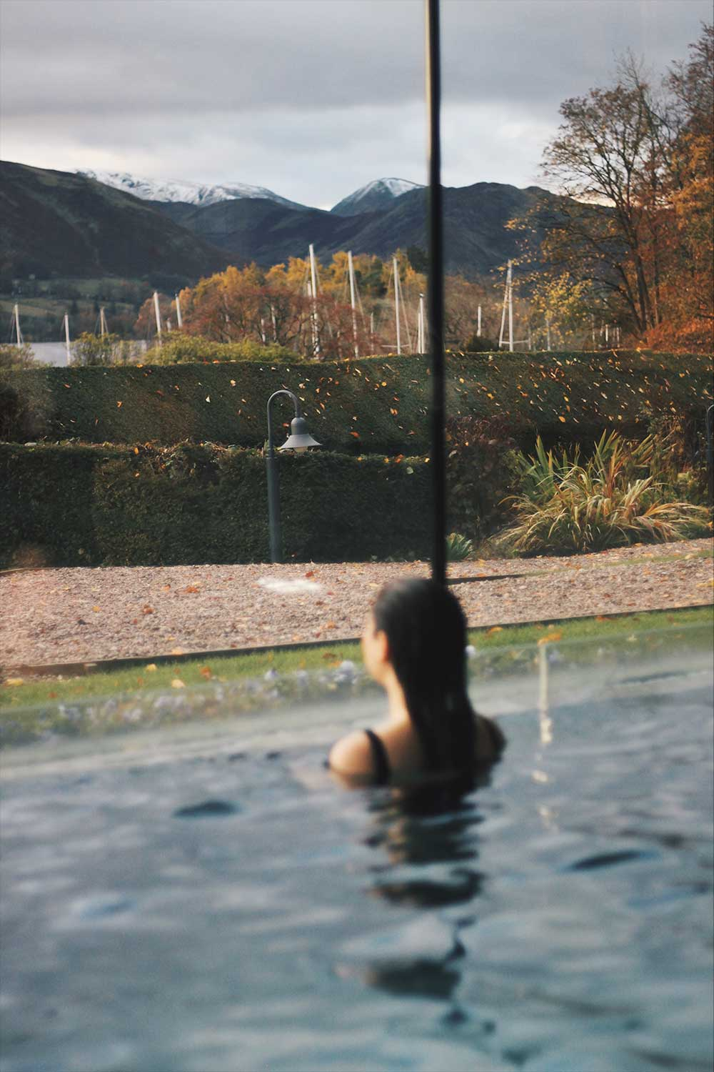 Emma Lavelle looking out from the pool over the lake