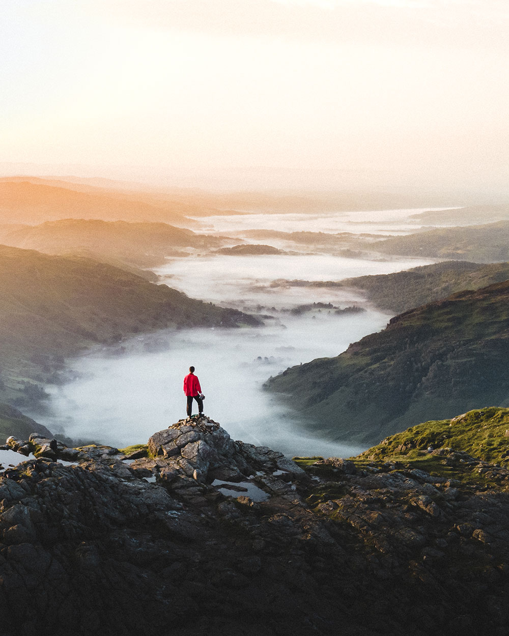 Photographer Ryan Lomas looks out over a mist filled valley in the Lakes