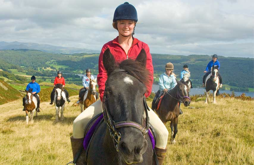 Woman horse riding in the Lake District