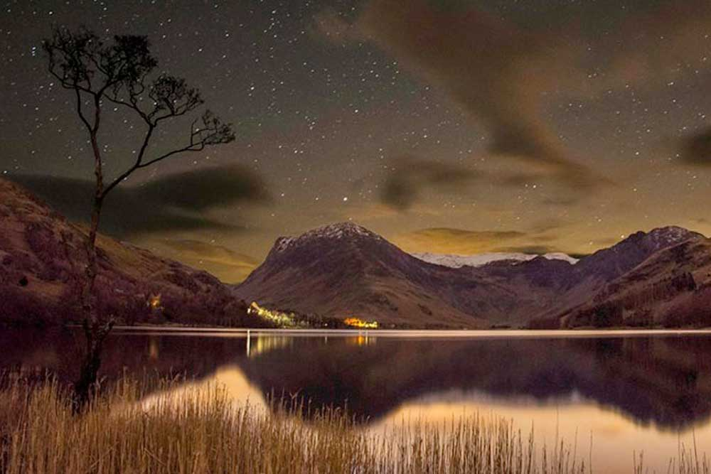 Starry sky and snow-capped fells in the Lake District