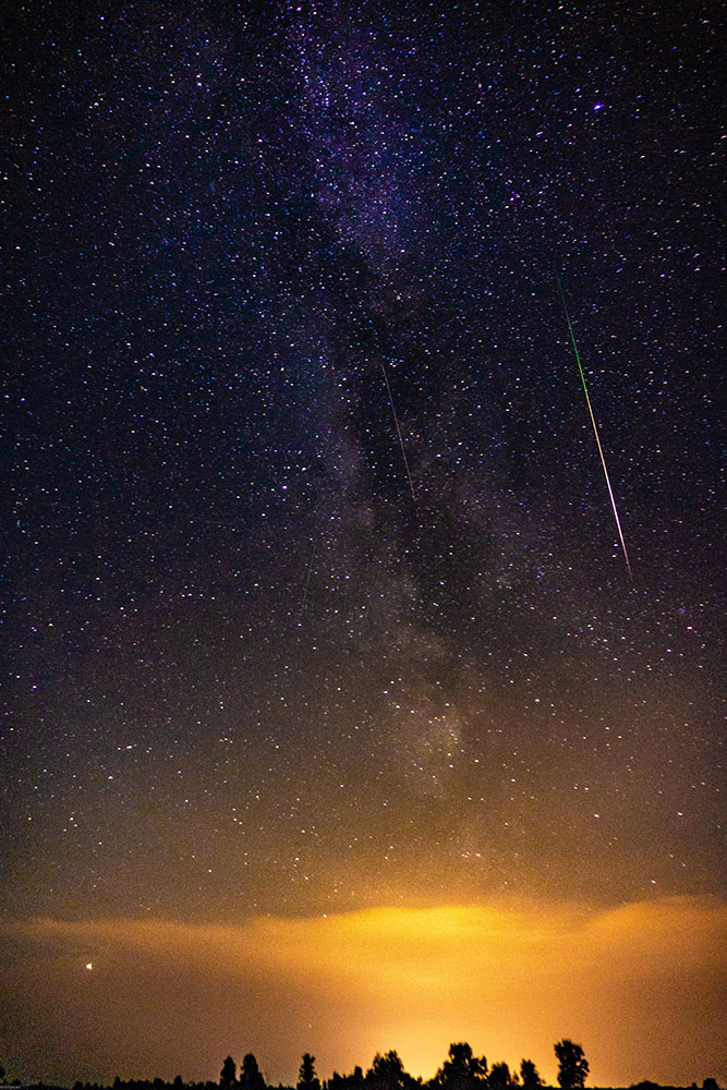 A meteor falls at sunset